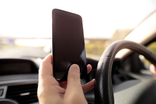 A driver holding a cellphone